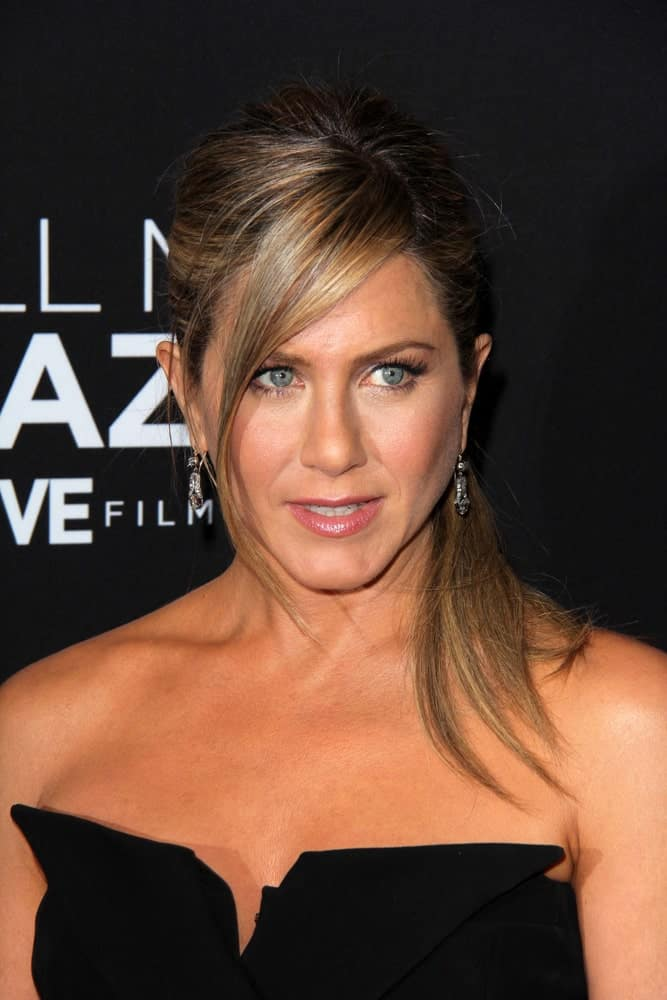 "Jennifer Aniston went with a classic ponytail incorporated with long side bangs at the ""Call Me Crazy: A Five Film"" Premiere at the Pacific Design Center on April 16, 2013."