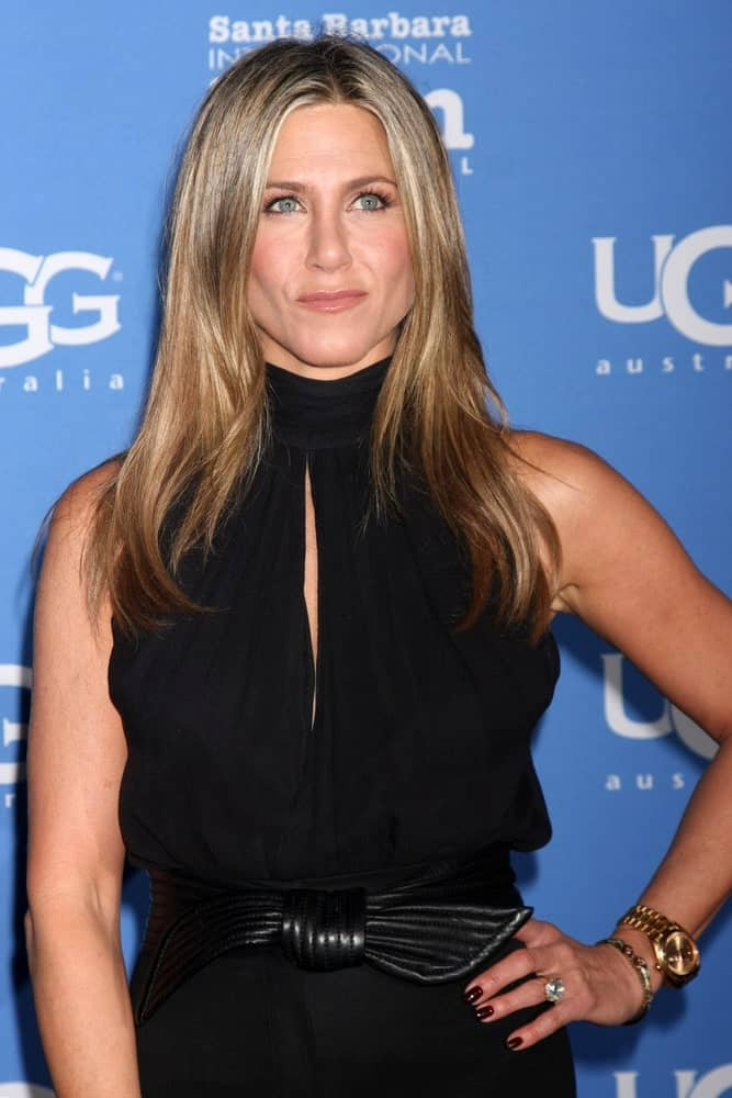 Jennifer Aniston with a long straight hairstyle in sandy blonde at the Santa Barbara International Film Festival – Montecito Award 2015 held on January 30th. She looks very classy with her natural-looking style, perfect for her black dress.