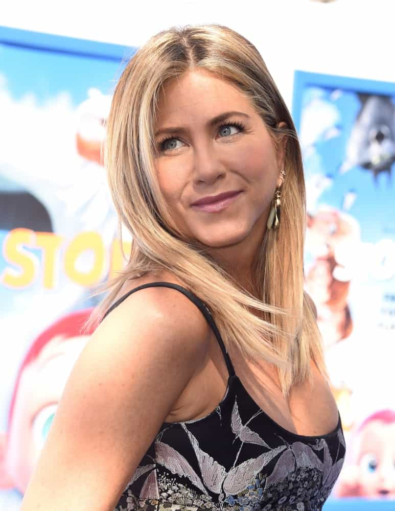 "Jennifer Aniston is oozing with a charm featuring her straight blonde hair at the ""Storks"" World Premiere on September 17, 2016, in Westwood, CA."