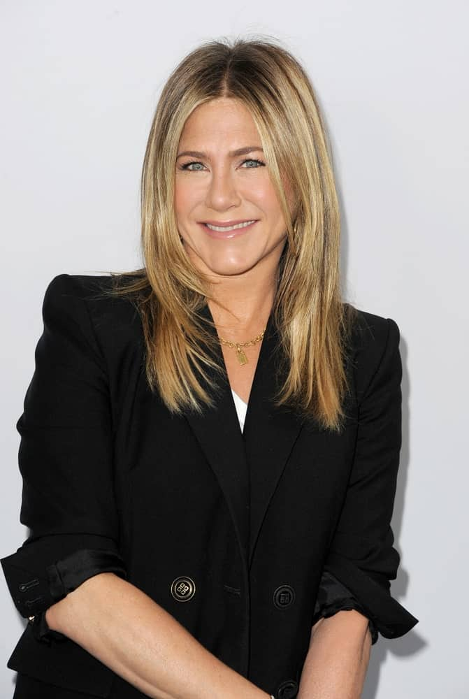 Jennifer Aniston was spotted at the WE Day California held at The Forum in Inglewood, the USA on April 19, 2018. She wore a black blazer that contrasts her blonde hair styled with feathered layers.