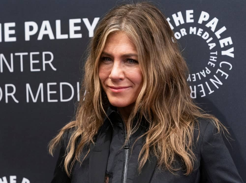 Jennifer Aniston paired her black dress by Madison Margiela with a tousled wavy hairstyle at the PaleyLive NY: Apple TV The Morning Show Preview Screening last October 29, 2019.