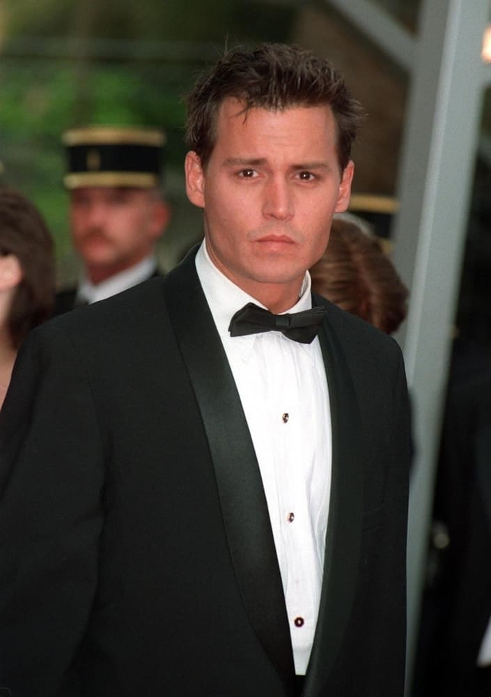 Last May 11, 1997, Johnny Depp was at the 1997 Cannes Film Festival. wearing a classy suit to match his clean-shaved fresh face and spiky crew cut hair.