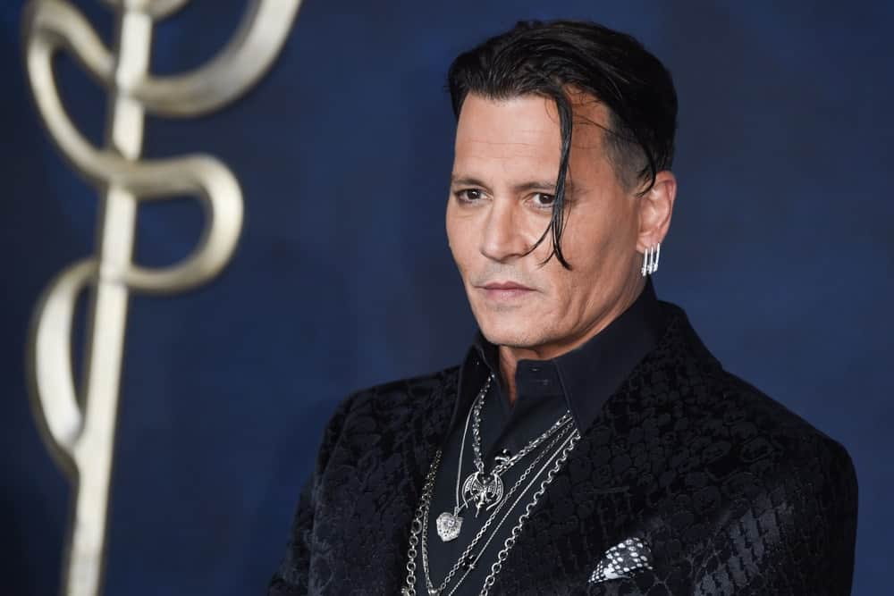 Last November 13, 2018, Johnny Depp was at the premiere for Fantastic Beasts: The Crimes of Grindelwald at Leicester Square. He showed up with a pitch-black detailed suit and a long undercut hairstyle.
