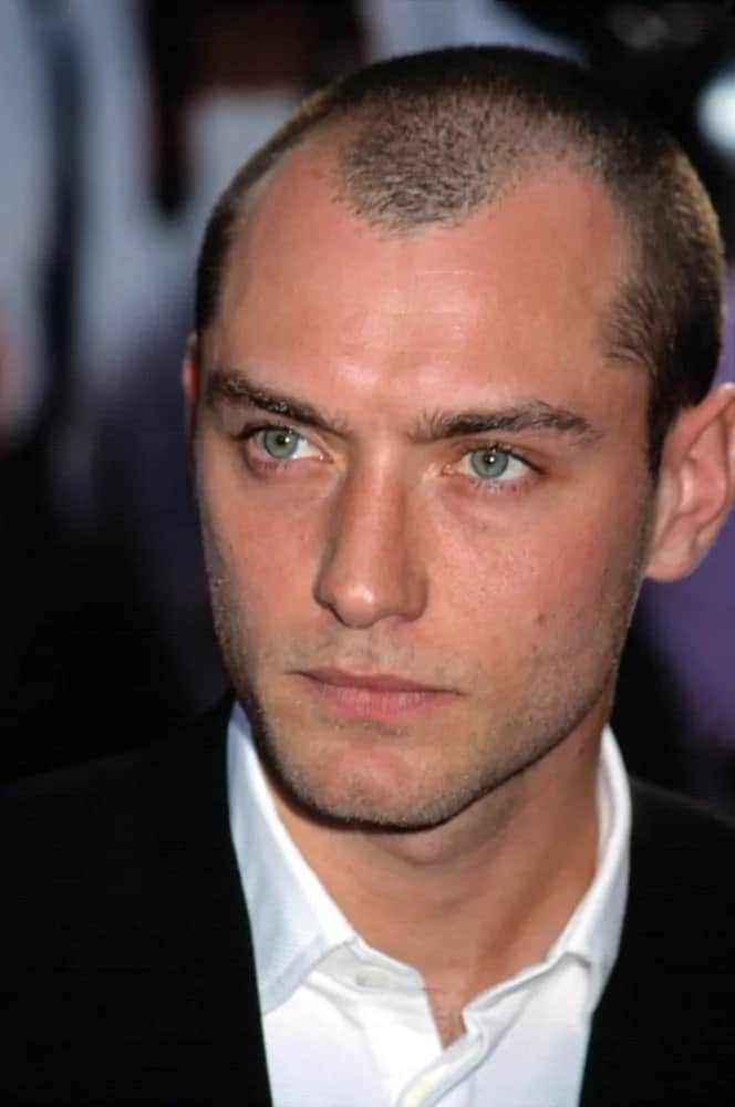 """Jude Law went for an edgy style with his buzz cut hairstyle and five o'clock shadow at the 2001 world premiere of """"Artificial Intelligence"""" in New York."""