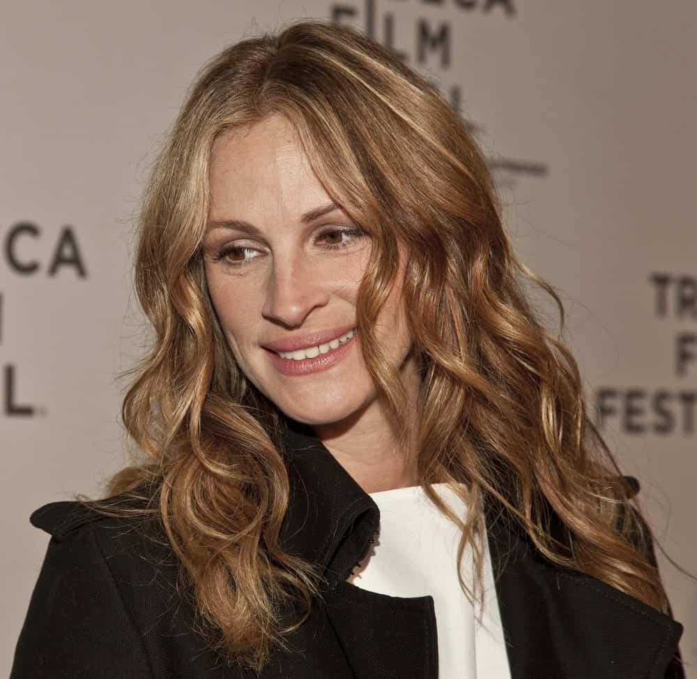 "On April 23, 2011, Julia Roberts arrived for the premiere of ""Jesus Henry Christ"" at the 2011 Tribeca Film Festival with soft highlighted curls paired with a black coat."