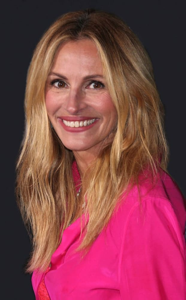 "Julia Roberts arrived at the ""Homecoming"" Premiere Screening at the Village Theater on October 24, 2018, with a tousled center-parted hairstyle incorporated with subtle waves."