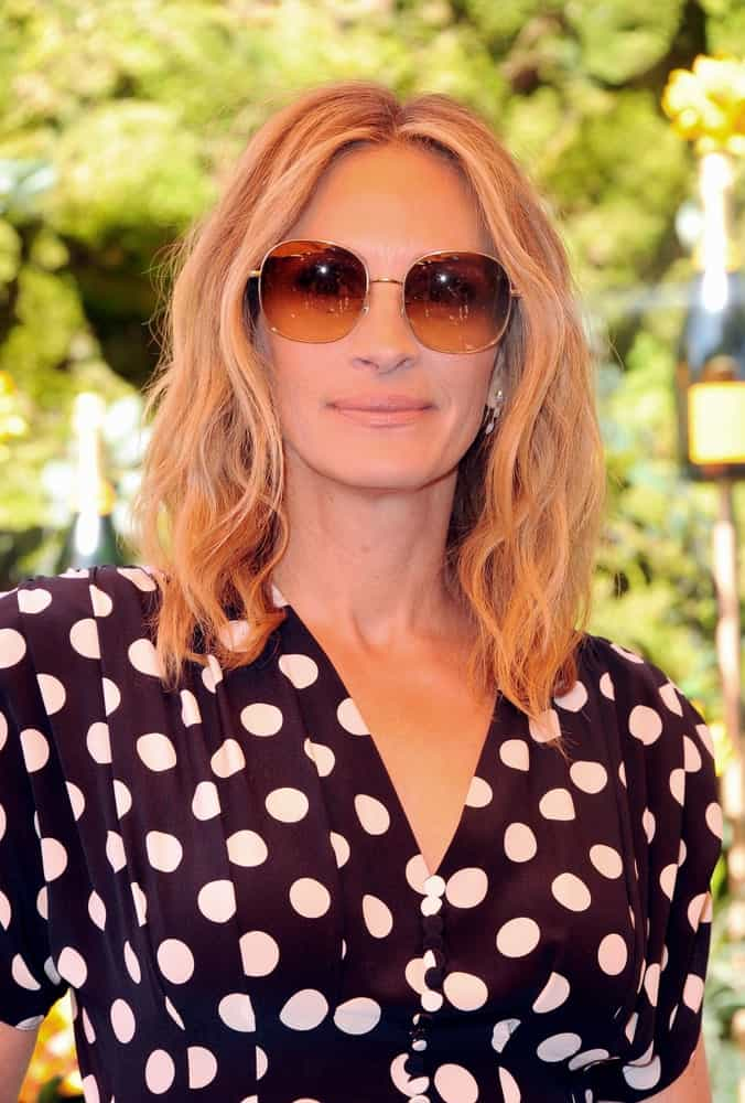Julia Roberts wore a black dotted dress and brown shades along with center-parted blonde waves at the 10th Annual Veuve Clicquot Polo Classic held on October 5, 2019.