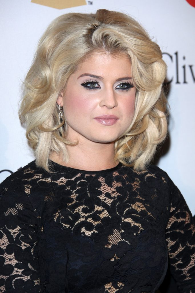 Kelly Osbourne spotted at the February 12, 2011 Pre-GRAMMY Gala And Salute To Industry Icons at Beverly Hilton Hotel, wearing a black elegant dress perfect with her blonde wavy hairstyle.