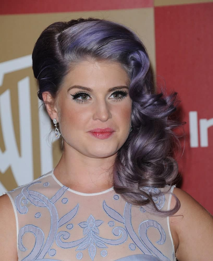 Kelly Osbourne boasting her striking purple and black hair. Photo was taken on January 13, 2013 at the WB/In Style Golden Globe Party in Hollywood, California.