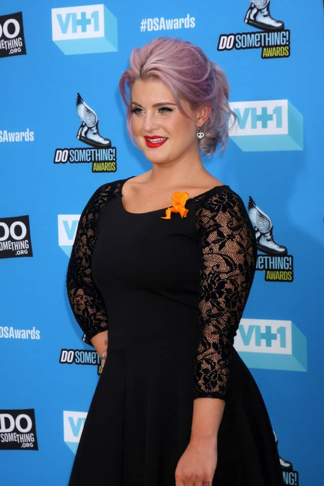 The beautiful Kelly Osbourne with her famous purple hair paired with a black dress at the 2013 Do Something Awards on July 31, 2013.