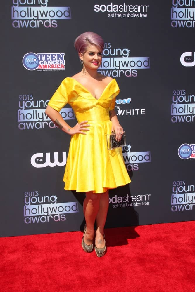A youthful-looking Kelly Osbourne in a yellow dress. She looks so cute in the dress, which is perfect with her hairstyle. Photo taken on August 1, 2013.