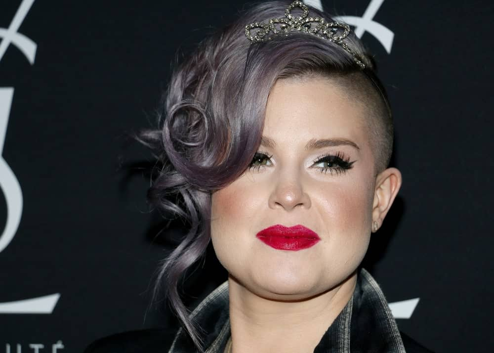 A headshot of the beautiful Kelly Osbourne with her stunning hairstyle and outfit. The photo was taken during the celebration of Zoe Kravitz for her new role with Yves Saint Laurent Beauty on May 18, 2016, held at the Gibson Brands Sunset in West Hollywood, USA.