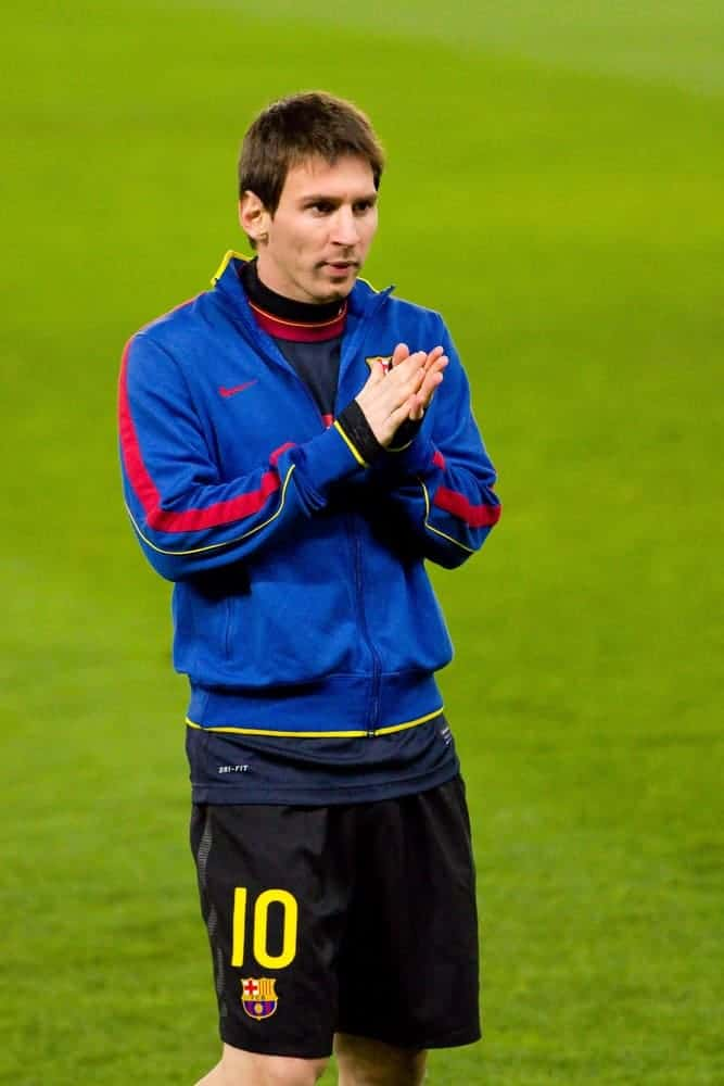 Lionel Messi of FC Barcelona warmed-up during the Spanish league match between RCD Espanyol and FC Barcelona on January 8, 2012, in Barcelona, Spain. He wore a jacket with his short Caesar hairstyle.