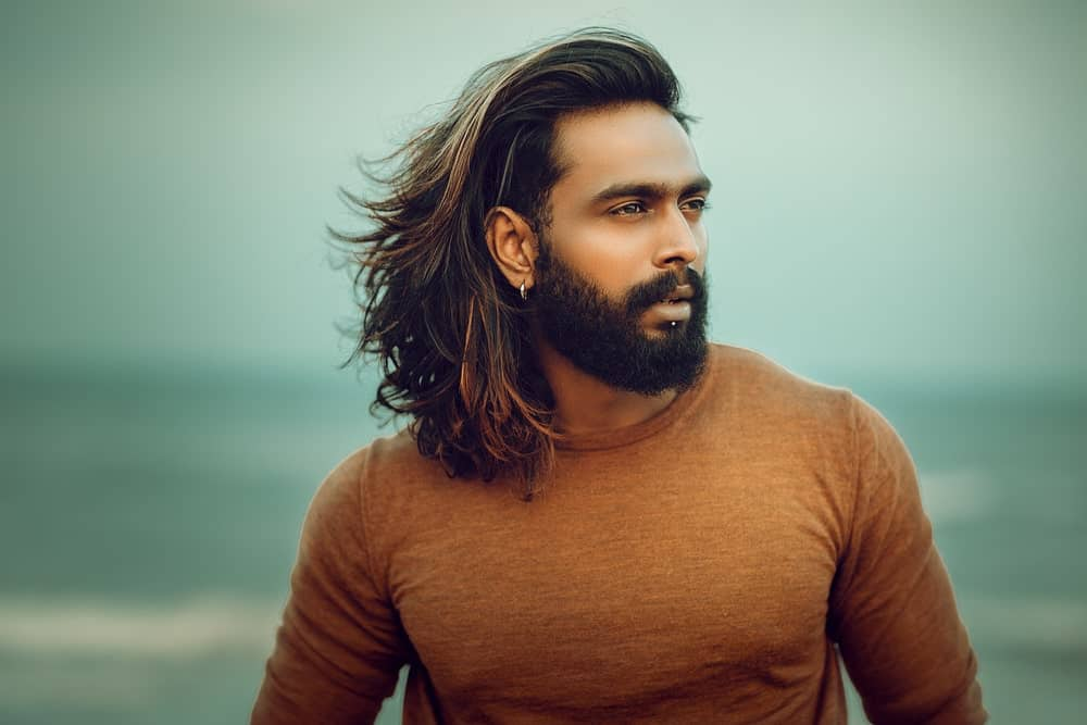 The good thing about a long hair with layers is that you can transform it into a man bun style or leave it as a messy hairstyle.