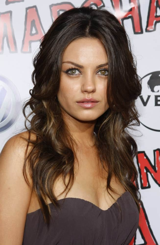 "Mila Kunis arrived at the World Premiere of ""Forgetting Sarah Marshall"" held at the Grauman's Chinese Theater in Hollywood last April 10, 2008. Her simple gray dress was complemented by her tousled and wavy layers with highlights."