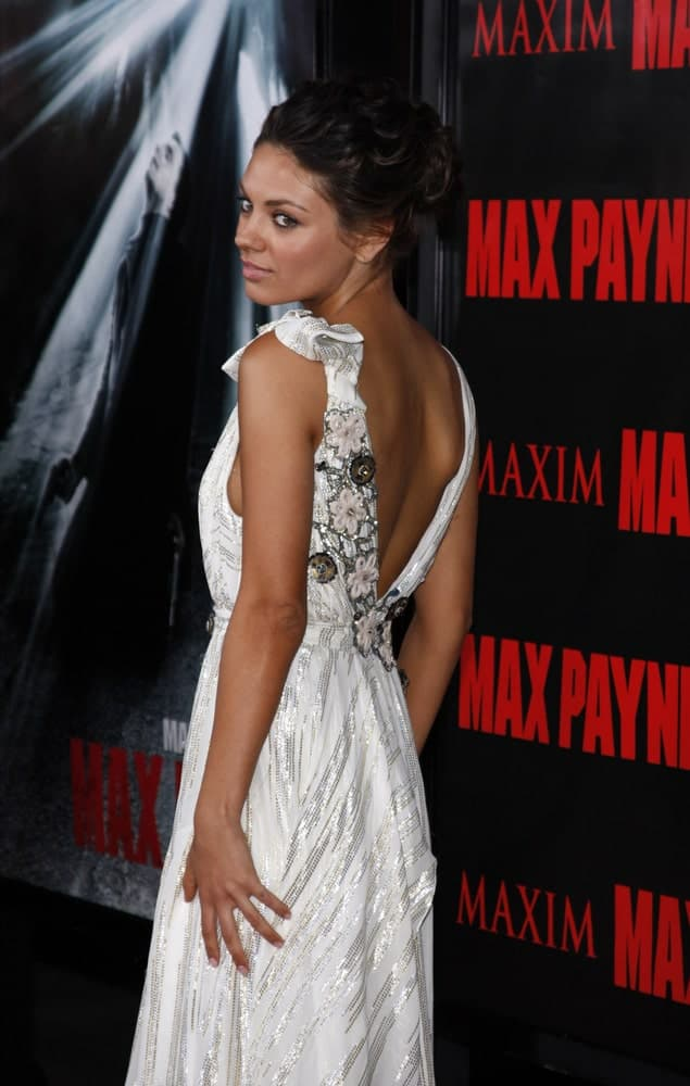 Mila Kunis attended the Los Angeles premiere of 'Max Payne' held at the Grauman's Chinese Theater in Los Angeles last October 13, 2008. Her stunning white dress made her stand out especially with her gorgeous wavy upstyle.