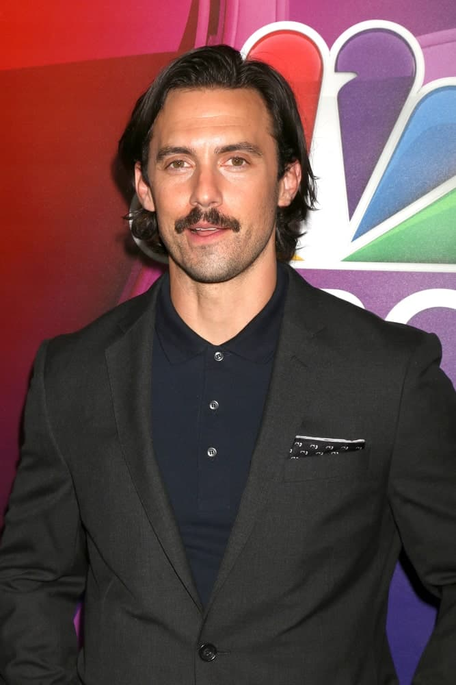 During the NBCUniversal TCA Summer 2016 Press Tour on August 2, 2016, Milo Ventimiglia had long side-swept hair paired with a mustache.