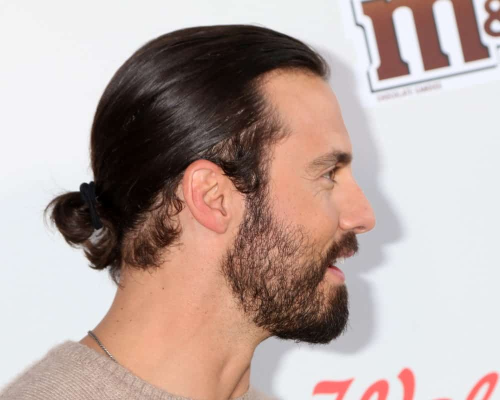 Milo Ventimiglia gathered his long black hair in a slicked man bun during the Red Nose Day 2016 Special at Universal Studios held on May 26th.