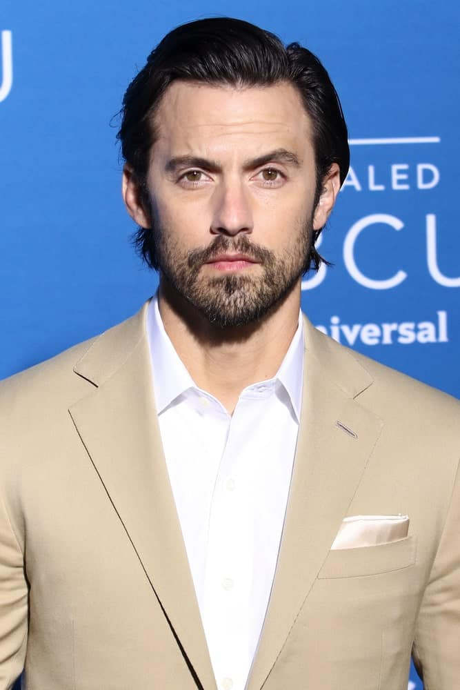 The actor looking gorgeous with a brushed up hairstyle incorporated with a stubble beard. This was taken at the 2017 NBCUniversal Upfront on May 15, 2017, in New York.