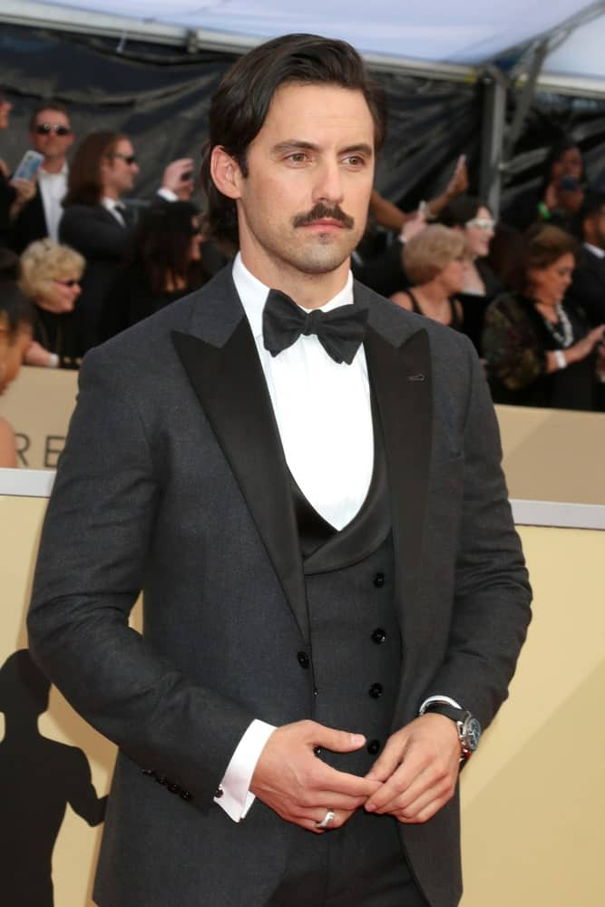 Milo Ventimiglia styled his wavy thick hair in a deep side part during the 24th Screen Actors Guild Awards - Press Room at Shrine Auditorium on January 21, 2018.