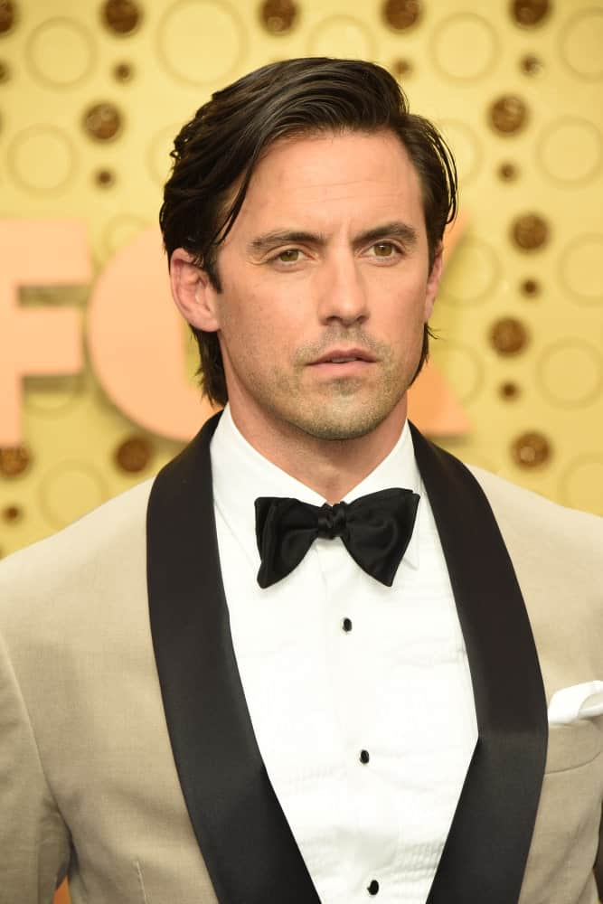 Milo Ventimiglia is a natural charmer with his side-swept hairstyle paired with a beige suit. This look was worn at the Primetime Emmy Awards – Arrivals at the Microsoft Theater on September 22, 2019.