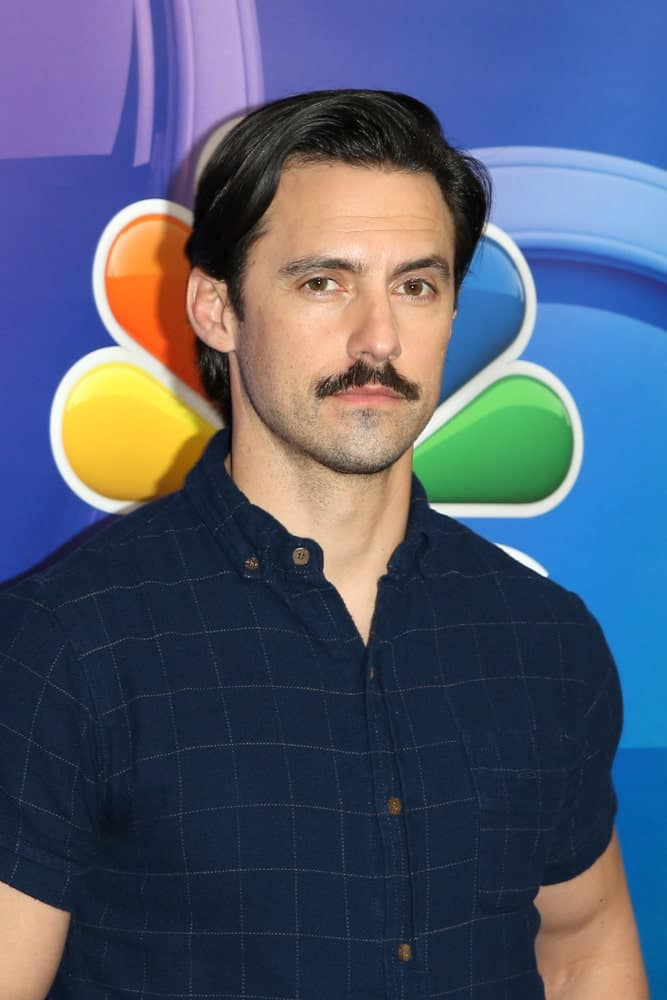 The iconic dad look featuring a side-parted hair plus a mustache sported by the actor Milo Ventimiglia at the NBC's Los Angeles Mid-Season Press Junket held on February 20, 2019.