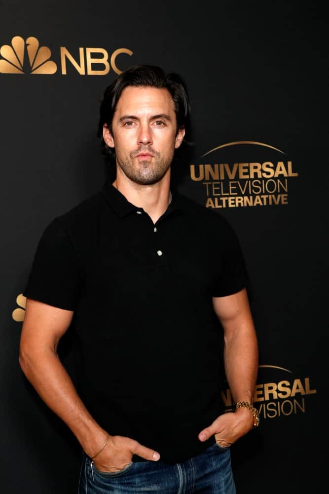 The actor's black side-parted hair is a perfect match with his plain polo shirt at the NBC And Universal EMMY Nominee Celebration at the Tesse Restaurant on August 13, 2019.