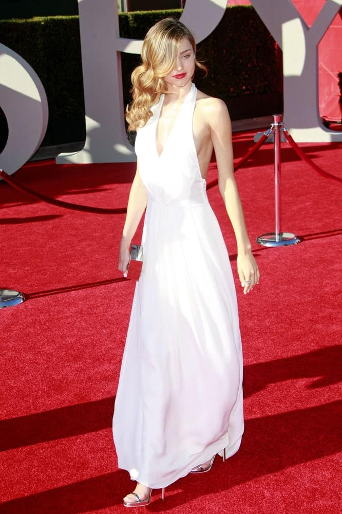 Miranda Kerr shines in a white halter dress along with her blonde curled locks gathered on one side. This look was worn during the 2009 ESPY Awards held at the Nokia Theater in Los Angeles, California on July 15th.