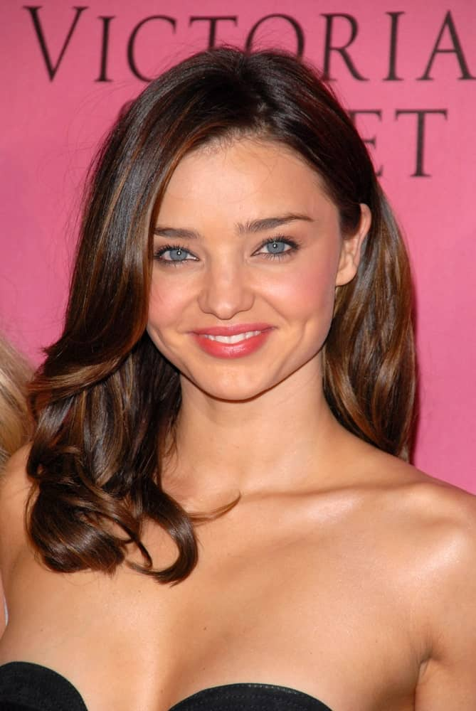 "Australian model Miranda Kerr looked gorgeous with her brunette highlighted locks that's side-parted and curled. This hairstyle was worn during the Victoria's Secret Supermodels Celebrate the Reveal of the 2010 ""What is Sexy?"" List: Bombshell Edition on May 11, 2010."