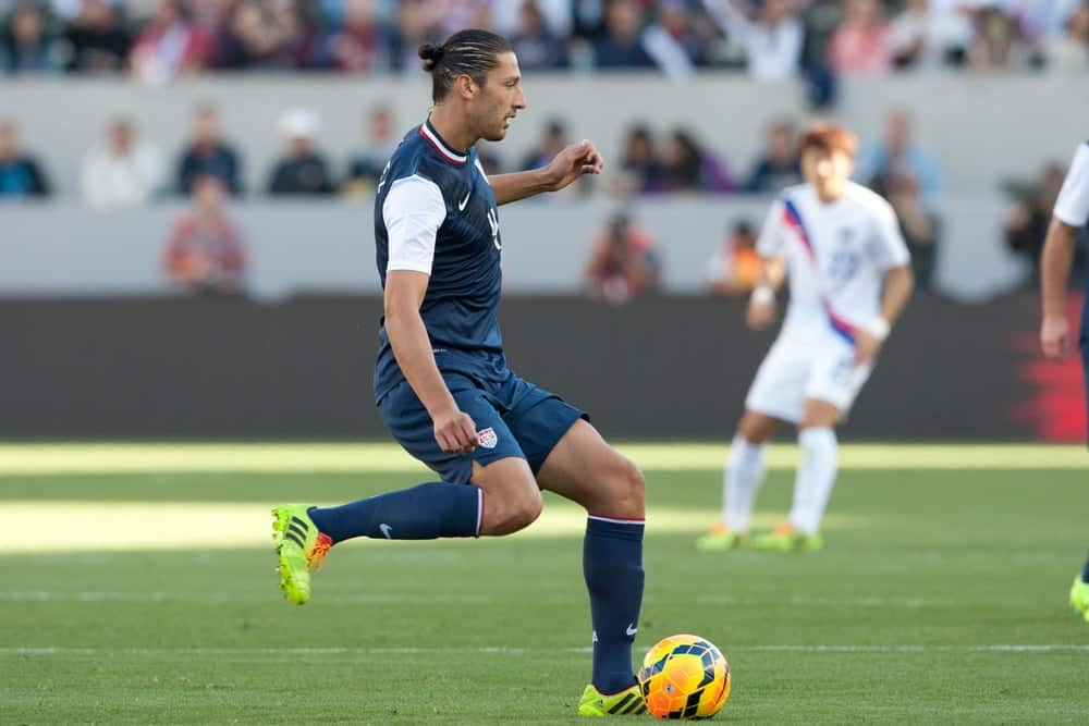 US Soccer Team defender, Omar Gonzales playing against Korea Republic on February 1, 2014, a friendly match in Carson, California. He is sporting a man bun hairstyle.