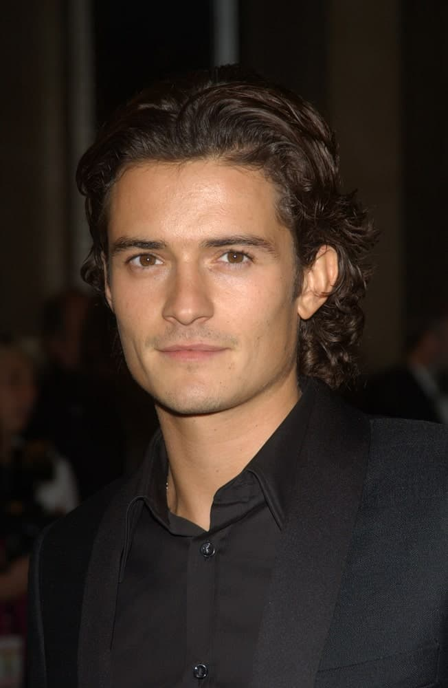 Actor Orlando Bloom was at the 2003 Hollywood Awards at the Beverly Hills Hilton. He was strikingly handsome in his classy black suit and slicked-back long dark curly hairstyle.
