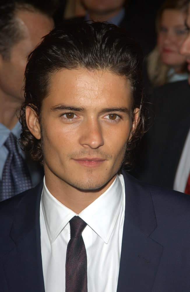"""Orlando Bloom's beautiful long curly hair was slicked back for a vintage look at the 2003 premiere of his new movie """"The Lord of the Rings: The Return of the King"""" in Los Angeles."""