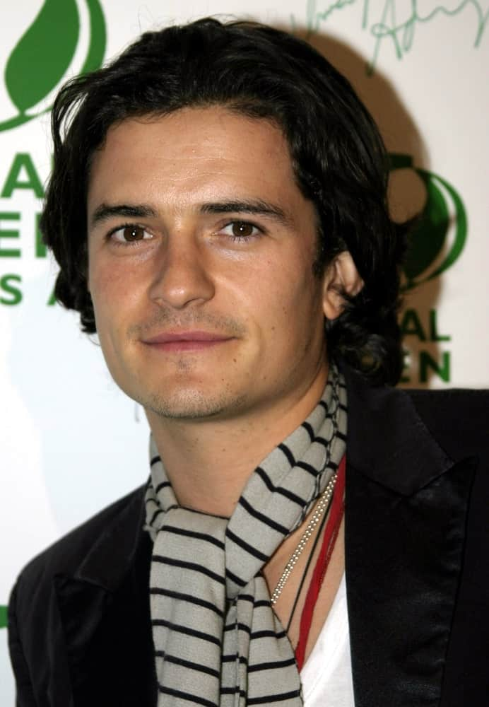 Orlando Bloom attended the Global Green Pre-Oscar Party held at the Day After Club in Hollywood, California on February 24, 2005. He wore a fashion-forward scarf that went well with his long dark curls.