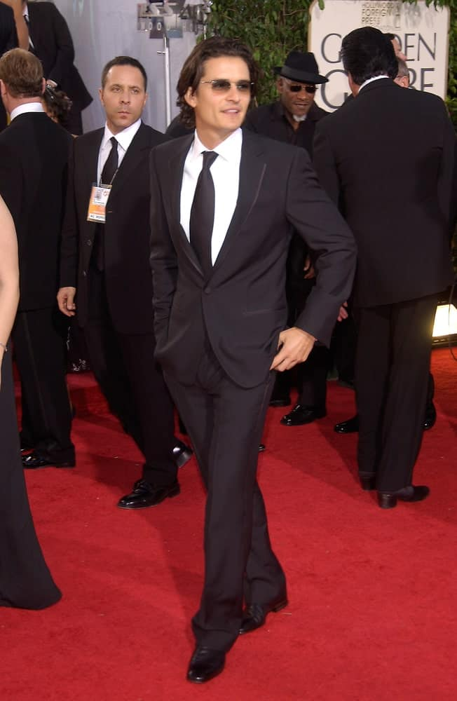 On January 16, 2005, Actor Orlando Bloom was at the 62nd Annual Golden Globe Awards at the Beverly Hilton Hotel. He was dapper in his classy black suit and long slick hair with slight curls at the tips.