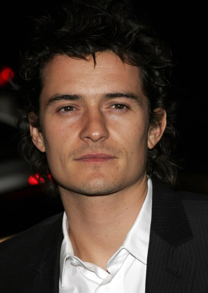 Orlando Bloom was gorgeous in his black suit and his messy tousled curly hairstyle with spikes at the Global Green USA Pre-Oscar Celebration to Benefit Global Warming held at the Avalon in Hollywood on February 21, 2007.