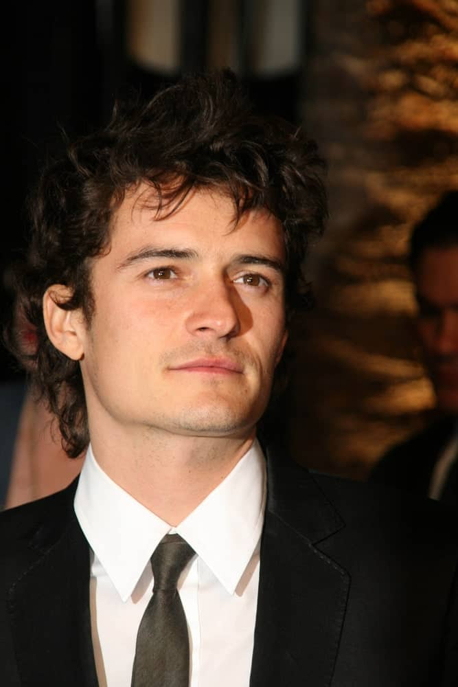 Orlando Bloom's beautiful hazel eyes are on full display with his spiky and curly hairstyle at the 2007 Vanity Fair Oscar Party in Mortons, West Hollywood, CA.