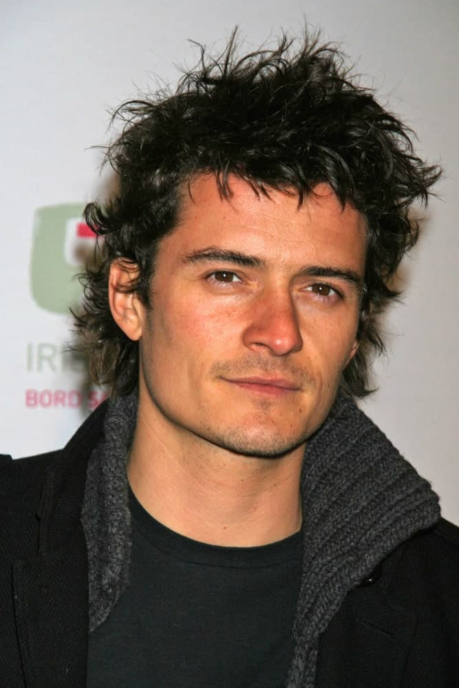 Orlando Bloom went for a messy and spiky hairstyle with his five o'clock shadow and casual outfit at the 2007 US-Ireland Allliance Gala. The Ebell Club of Los Angeles, Los Angeles, CA.