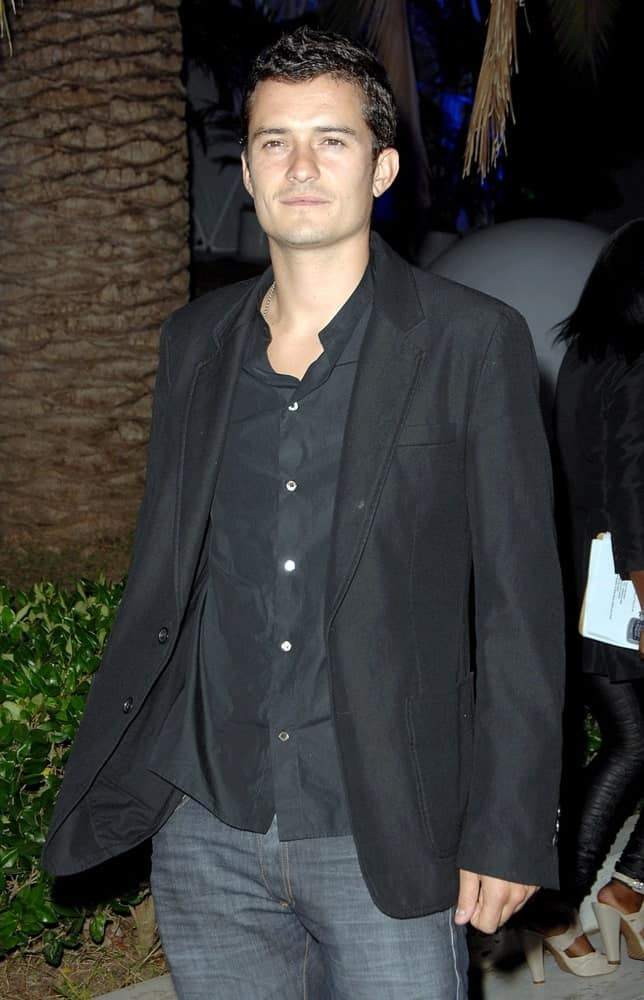 Orlando Bloom wore a smart casual ensemble outfit and jeans with his short and curly crew cut fade hairstyle at The Tar Estate in Bel Air, CA on August 23, 2008.