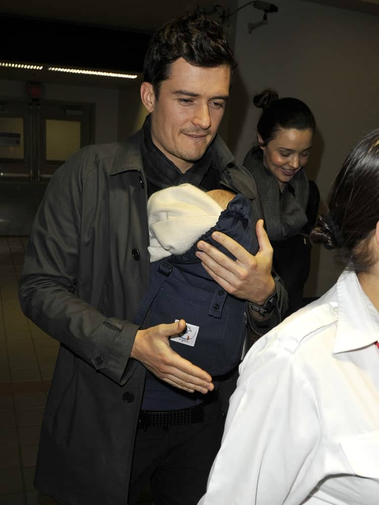 Actor Orlando Bloom was sporting a curly brushed up fade hairstyle with Miranda Kerr and their baby at LAX airport on March 5, 2010 in Los Angeles, California.