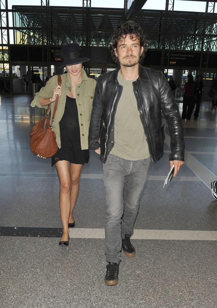 Actor Orlando Bloom and his wife were seen at LAX on September 9, 2010 in Los Angeles, California. Bloom was wearing a casual outfit to go with his long, curly and messy fringe hairstyle.