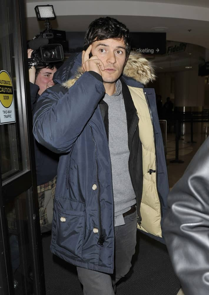 Actor Orlando Bloom reigned in his curls into a soft side-parted hairstyle when he was seen at LAX on January 25, 2010 in Los Angeles, California.