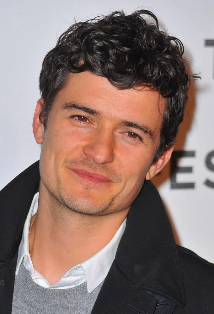 Orlando Bloom's casual winter clothes went quite well with his short curly fade hairstyle and five o'clock shadow at