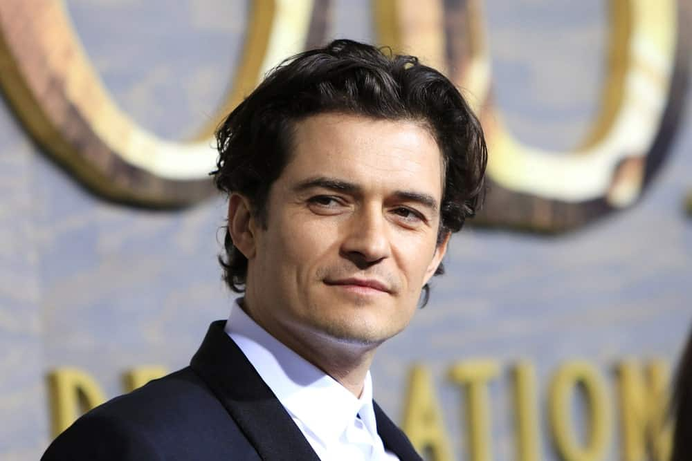 Orlando Bloom was at the premiere of Warner Bros' 'The Hobbit: The Desolation of Smaug' at the Dolby Theater on December 2, 2013 in Los Angeles, CA. He wore a dapper suit to balance his messy long curly hair that is perfectly tousled.