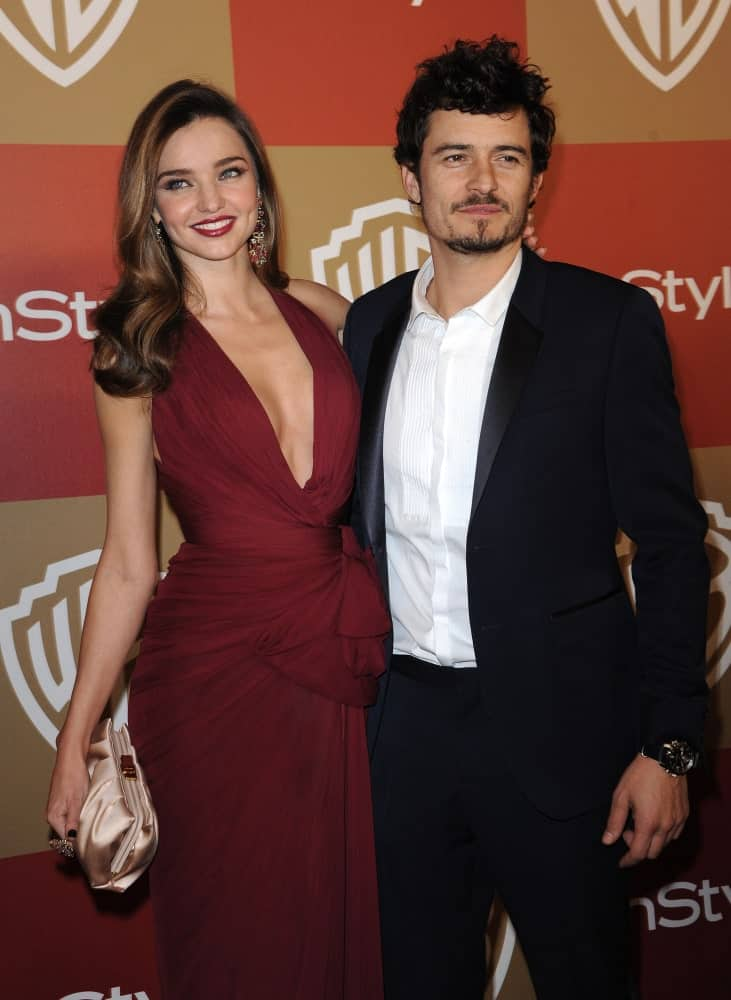 Miranda Kerr & Orlando Bloom attended the WB/In Style Golden Globe Party on January 13, 2013 in Hollywood. Bloom wore a smart casual outfit to go with his messy and curly pompadour hairstyle.
