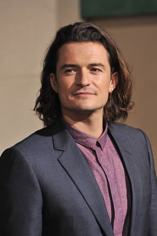 Orlando Bloom paired his smart casual outfit with a long and side-swept hairstyle with highlights at the 2014 Los Angeles premiere of his movie