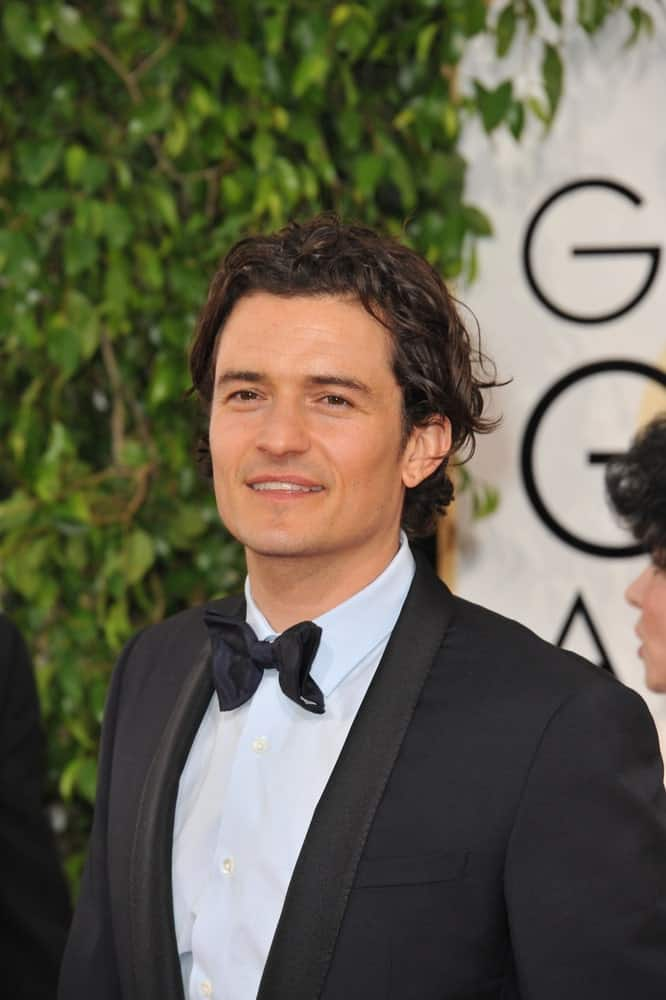 On January 12, 2014, Orlando Bloom attended the 71st Annual Golden Globe Awards at the Beverly Hilton Hotel. He went in his classy black tux and styled his long curly hair to be slick yet messy.