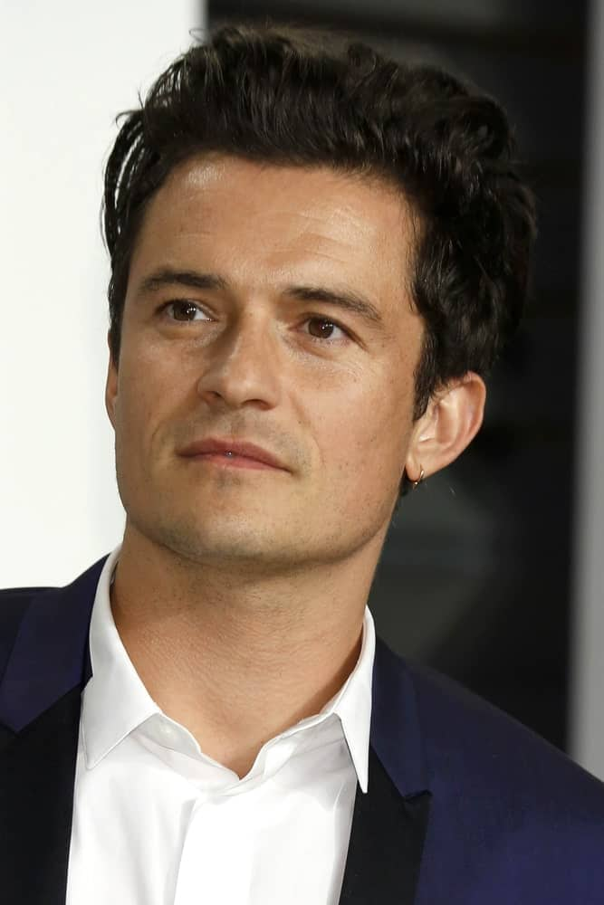 Orlando Bloom looked positively dreamy in his navy blue suit and messy pompadour hairstyle at the Vanity Fair Oscar Party on February 22, 2015 in Beverly Hills, CA.