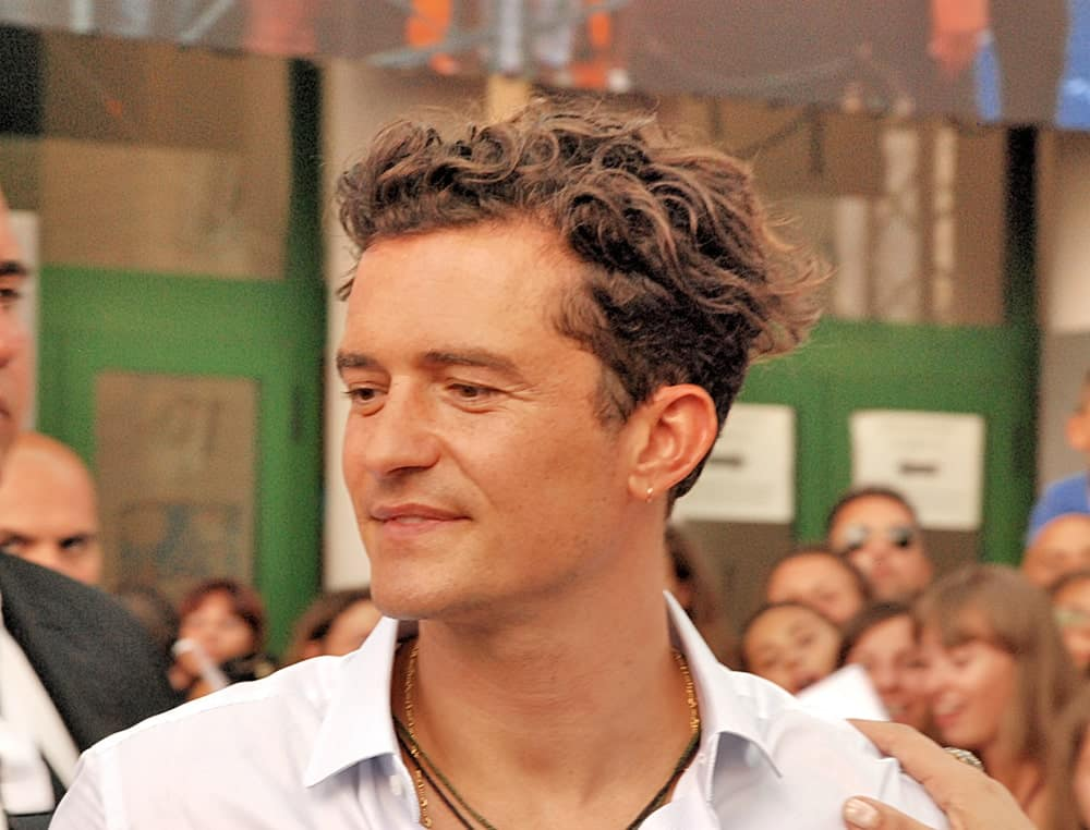 Actor Orlando Bloom's curly hair was styled into this wind-swept undercut look at the 2015 Giffoni Film Festival in Giffoni Valle Piana, Italy.