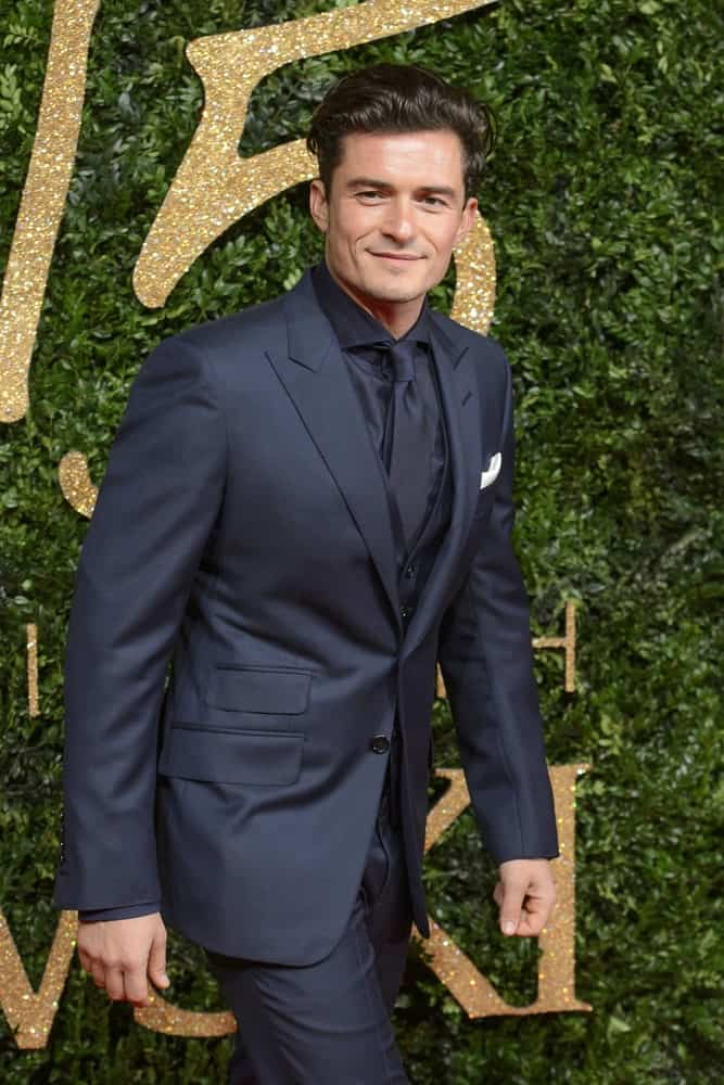 Orlando Bloom's handsome bone structure is on full display with his brushed-up undercut hairstyle with a slight pompadour look at the 2015 British Fashion Awards at the Coliseum Theatre in London.