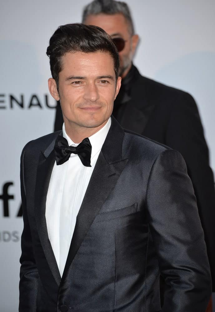 Actor Orlando Bloom's textured dark tux is complemented by his slick pompadour that is slightly swept to the side at the amfAR Cinema Against AIDS Gala 2016 at the Hotel du Cap d'Antibes.